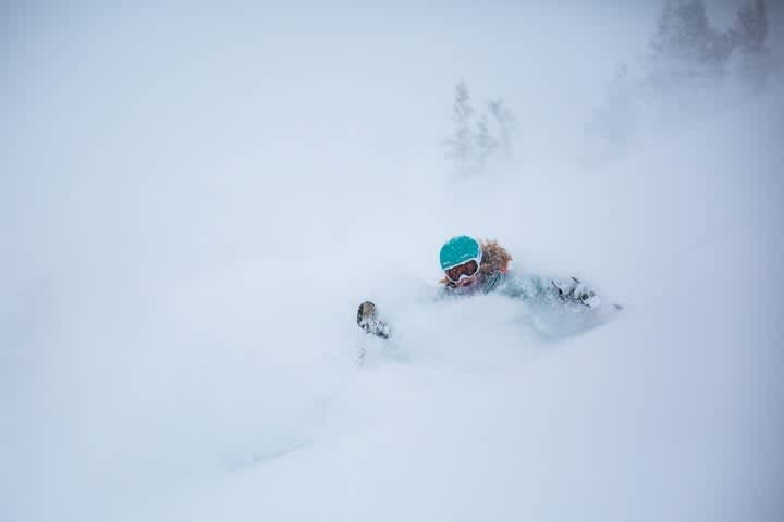 Madison Rose Ostergren emerges from two feet of January powder Photo: Rocko Menzyk