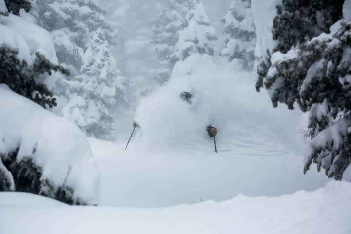 Skier getting over-the-head powder shot