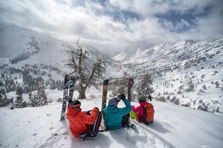 Skiers taking a moment to soak in the view down Little Cottonwood Canyon