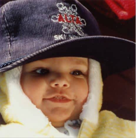 Portrait of baby Megan McJames wear Alta ballcap