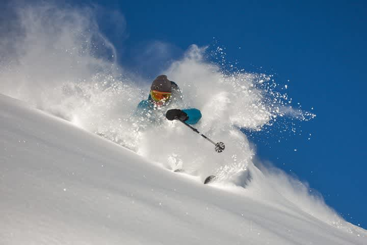 Dash Longe dives into a bluebird powder day in December Photo: Rocko Menzyk