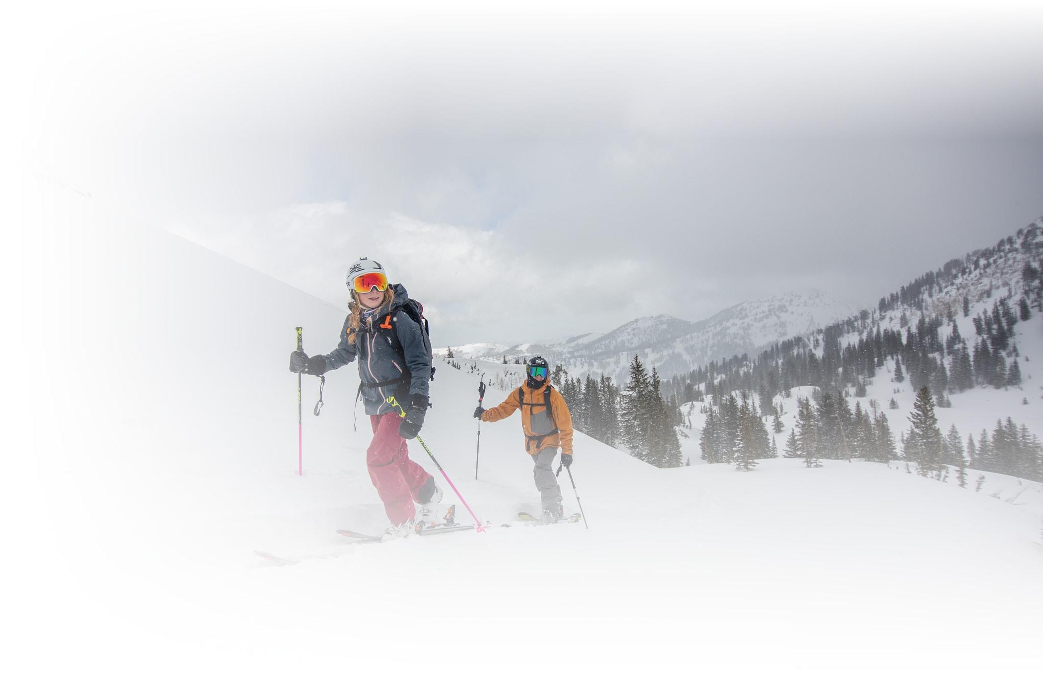 Skiers ski uphill