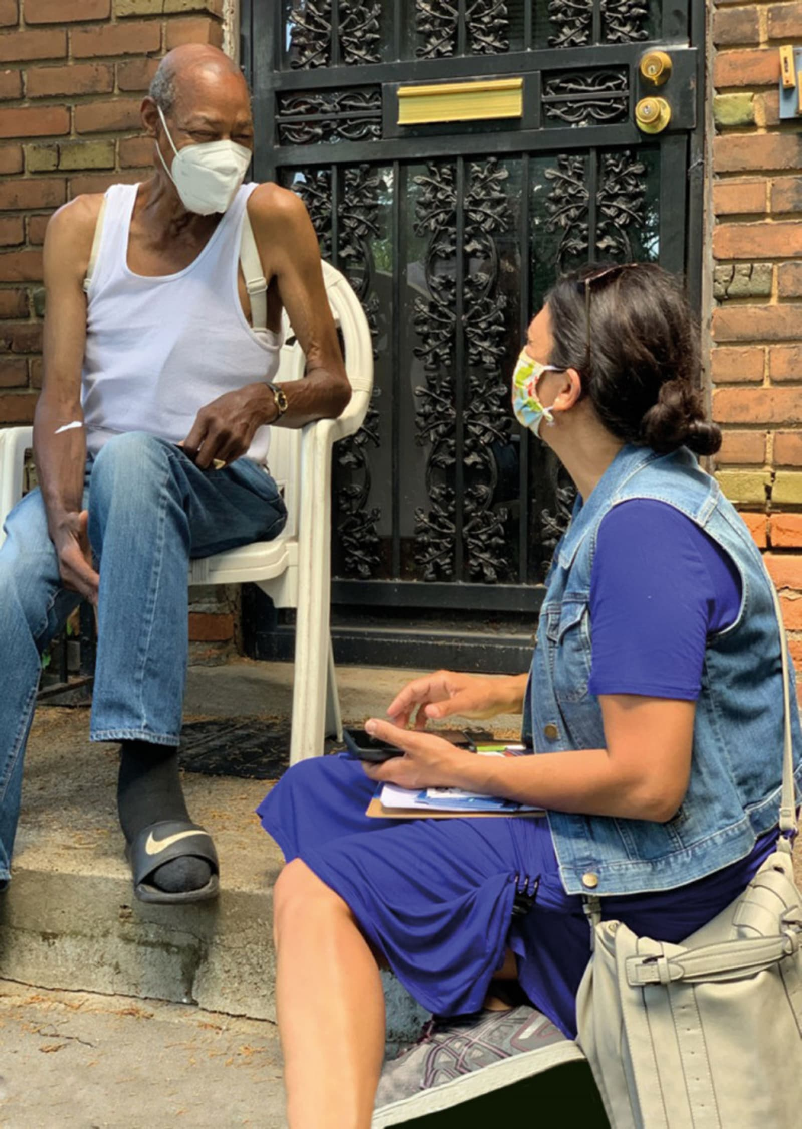 <p><em>The Congresswoman speaking with a Detroit resident. Photo: Supplied</em></p>\n
