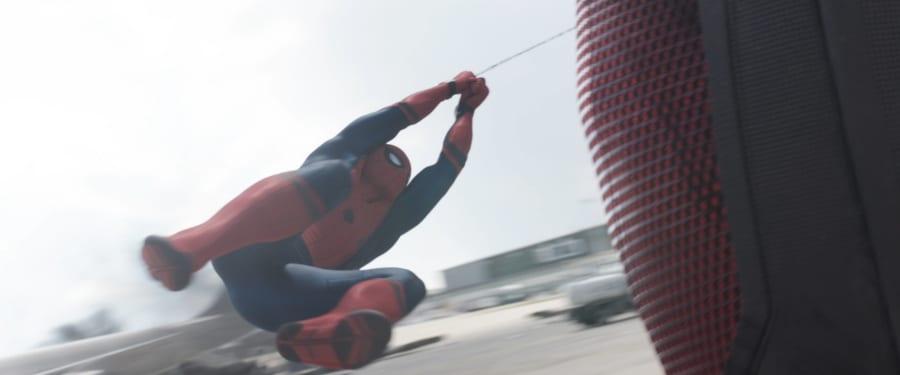 Spider-Man swings around Giant Man's leg