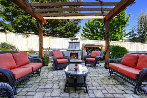 A beautiful outdoor living space can boost a home's curb appeal.
