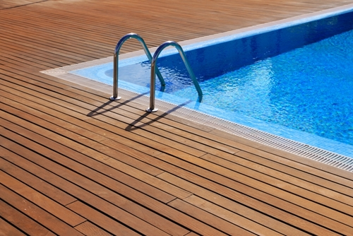 Take your pool to the next level by installing a deck around it.