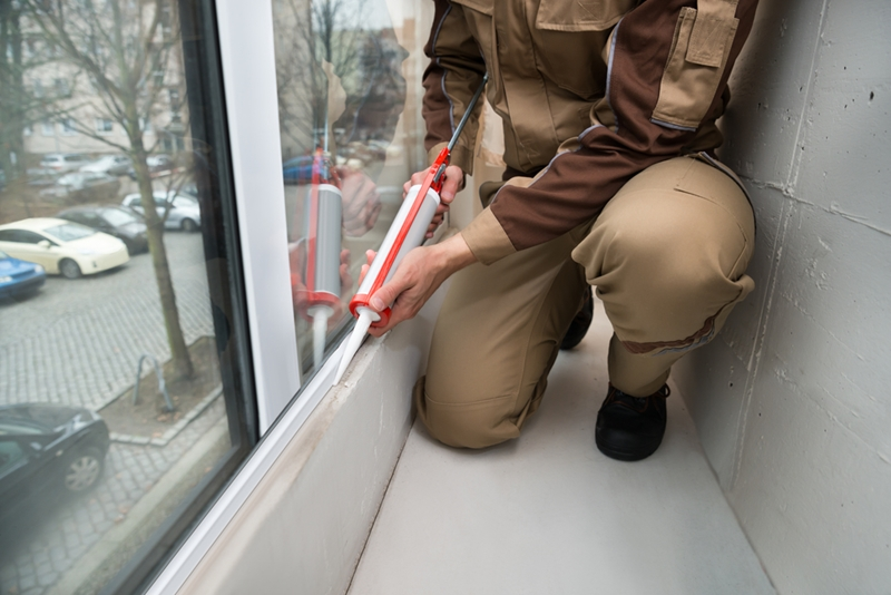 Seal cracks by caulking the windows.