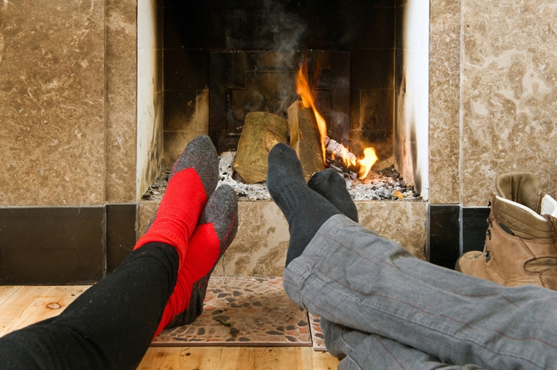 What better way to cozy up after a long day than near the fireplace?