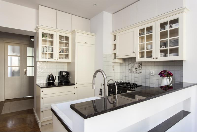 Kitchen with white cabinets.