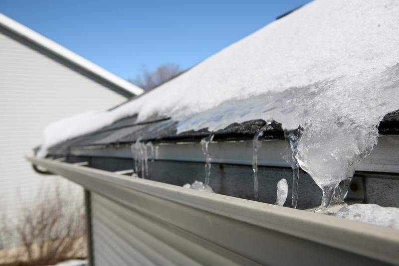 Snow and ice on roof and gutter.