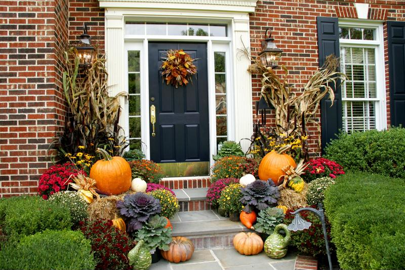 Mums and pumpkins are a classic pairing to decorate near your front door