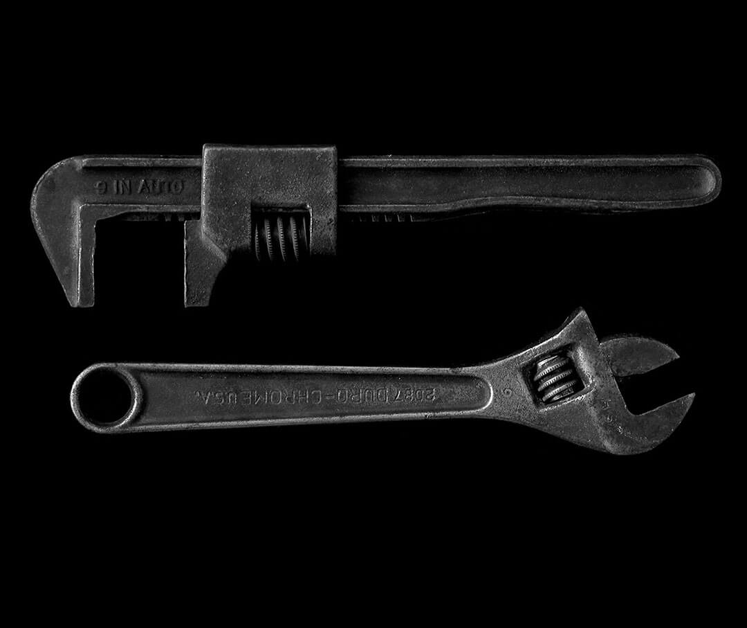 Two pipe wrenches.