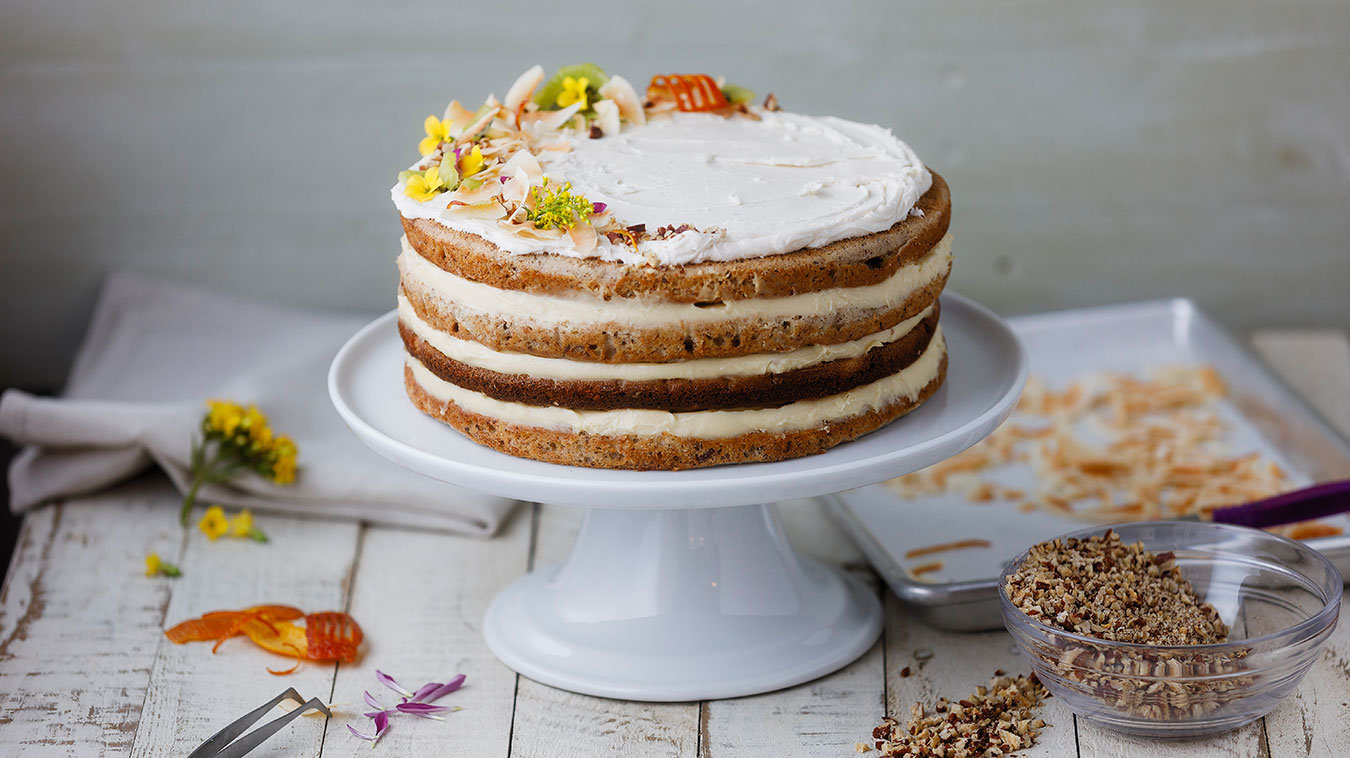 Hummingbird Cake with flowers and pecans
