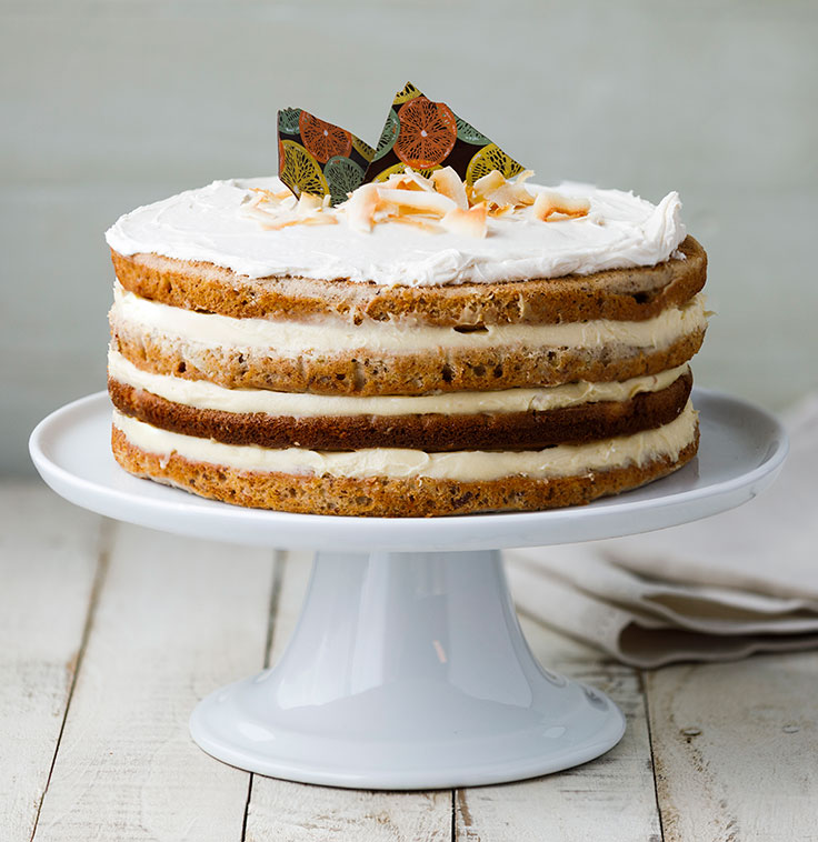 Hummingbird Cake with chocolate shards and toasted coconut flakes