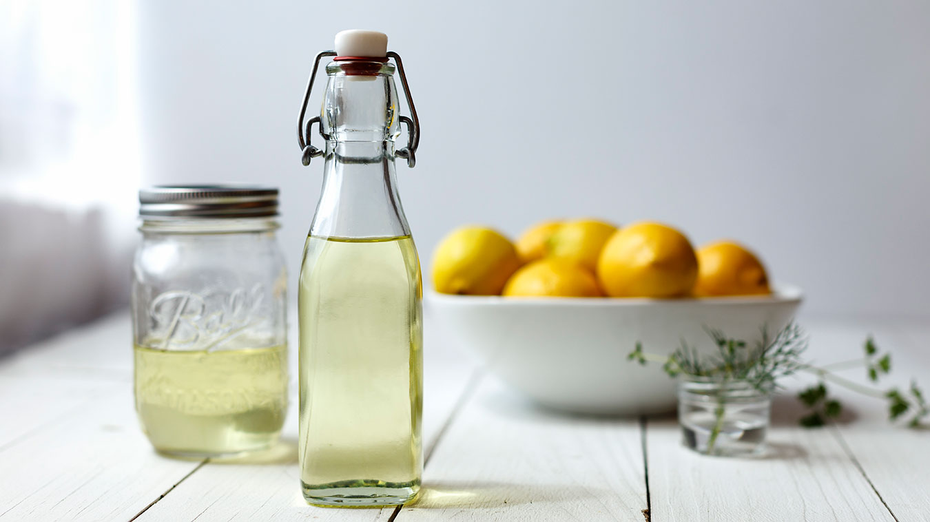 Lemon Oil with bowl of lemons