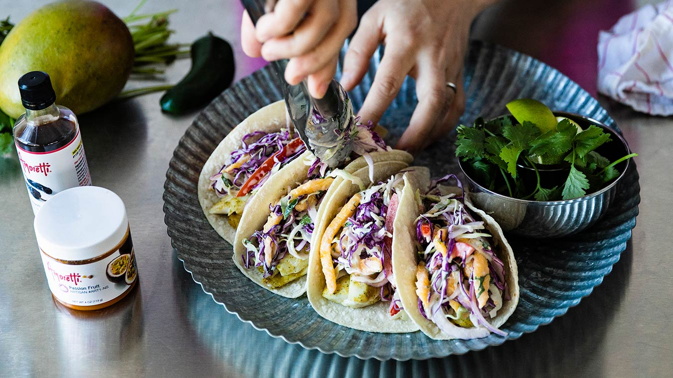 Amoretti Recipe: Fish Tacos with Mango Slaw and Chipotle Lime Aioli. Top fish with Mango Slaw.