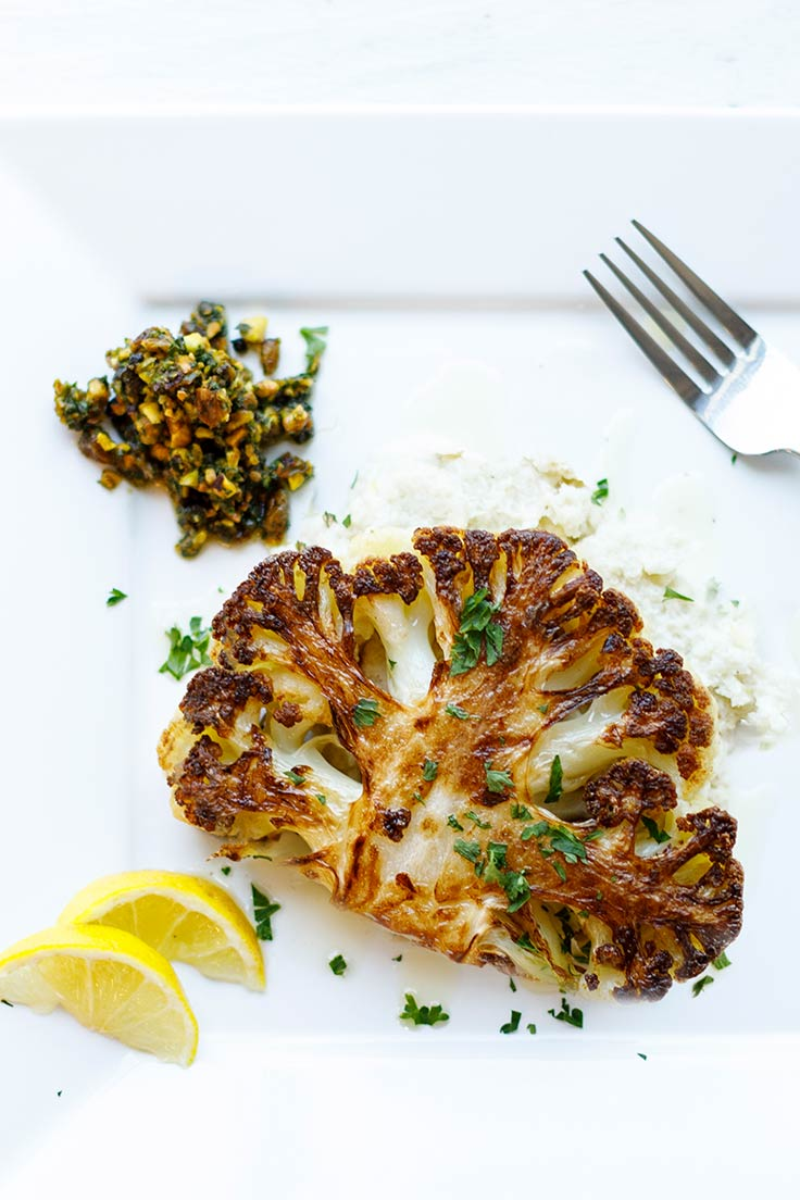 Amoretti Cauliflower Steaks with Pistachio Caper Salsa Recipe: This vegetarian main is a real people-pleaser!