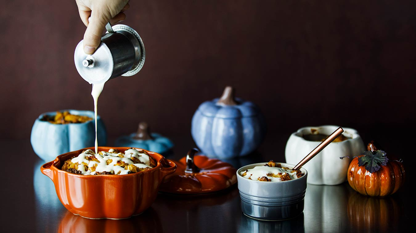 Amoretti Pumpkin Spice & Pear Bread Pudding Recipe, pouring Pear Anglaise over pudding