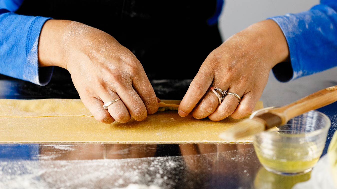 Amoretti Recipe: Agnolotti. Fold edge tightly over filling.