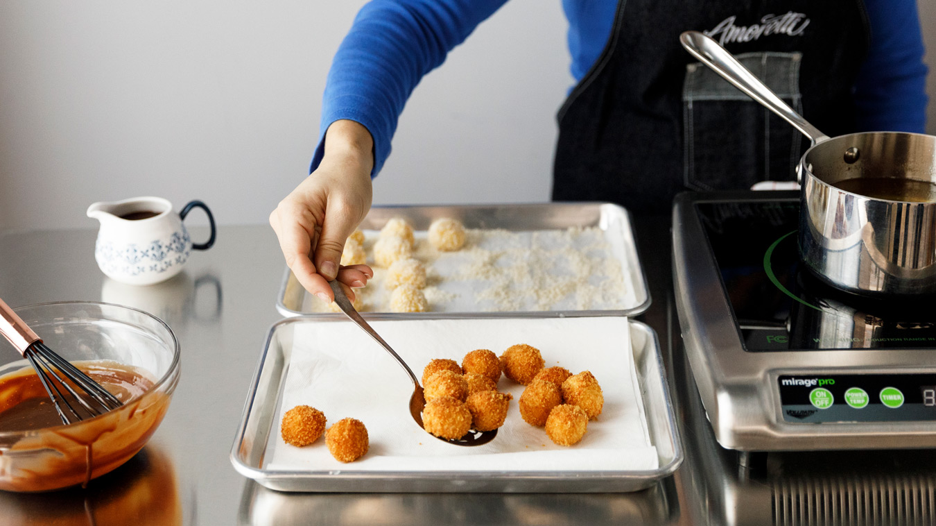 Amoretti Recipe: Horchata Arancini with Mexican Coffee Dipping Sauce. Fried arancini.