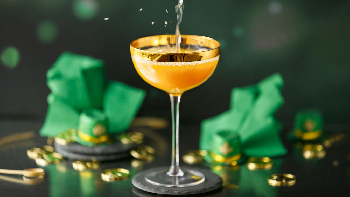 Amoretti Recipe: pouring our Leprechaun Lemonade Cocktail