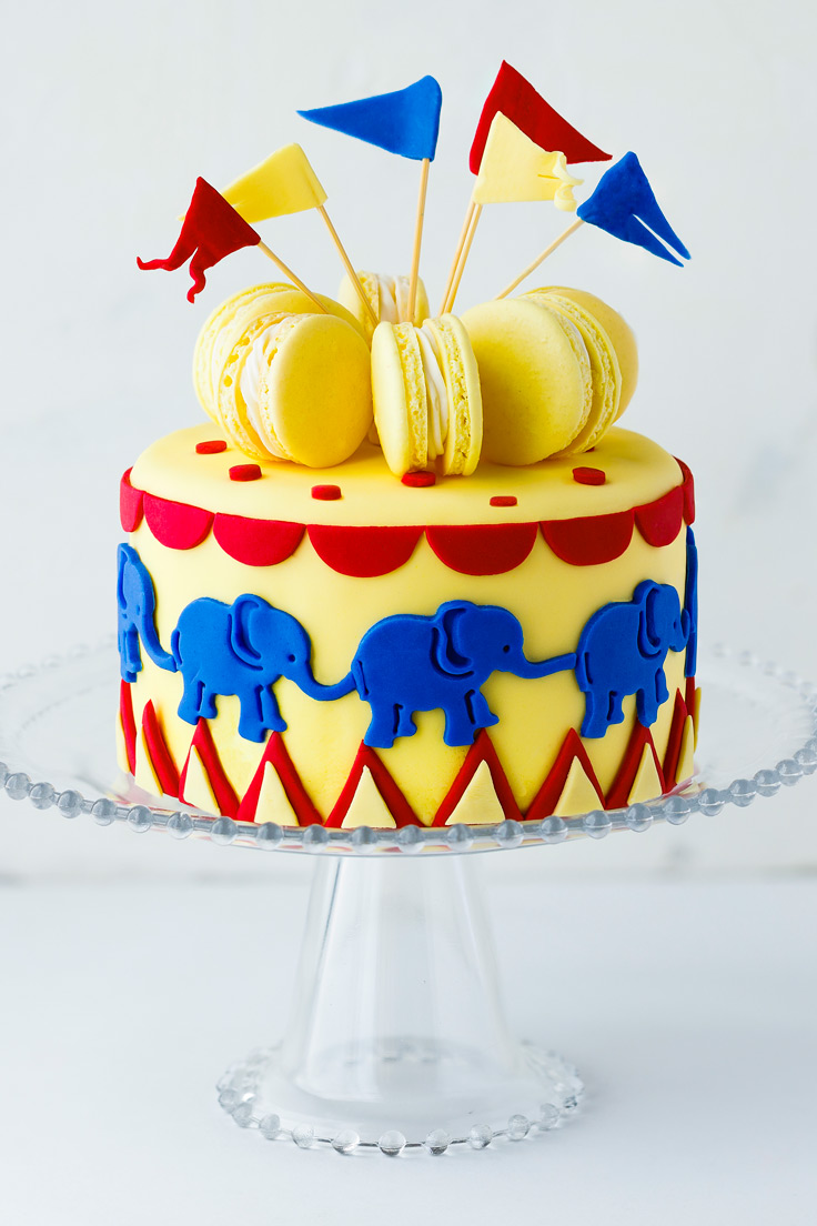 Amoretti Recipe: Lemon Macarons from Chef Colette, decorating a layer cake for the realease of the new Dumbo film