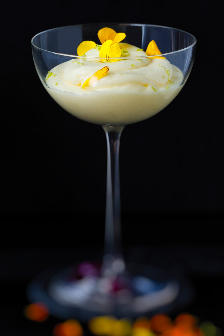 Amoretti Tropical Citrus Mousse Recipe decorated with yellow edible flowers