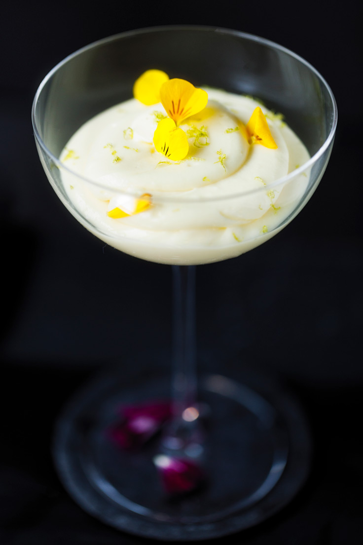 Amoretti Tropical Citrus Mousse Recipe decorated with yellow edible flower petals