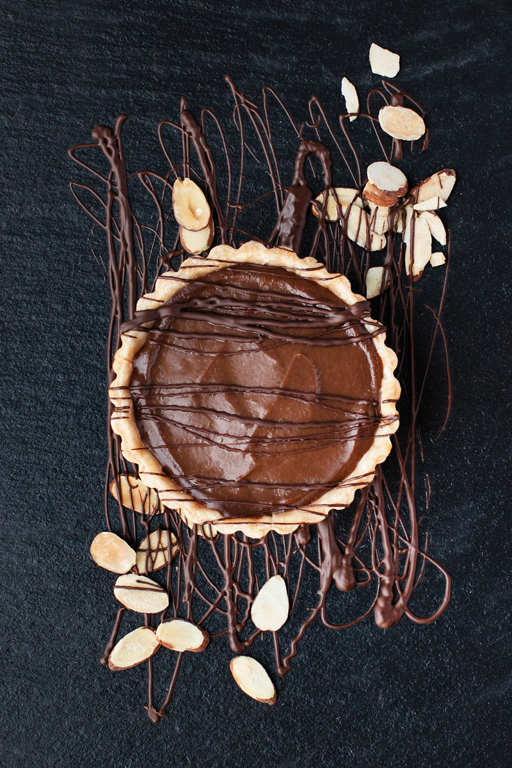 Amoretti Almond Dark Chocolate Cream Pie Recipe with chocolate drizzle and sliced almonds