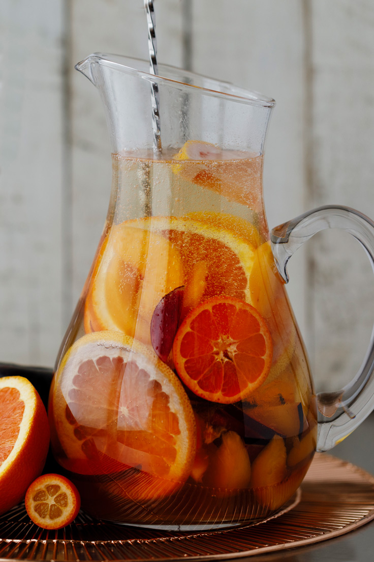 Amoretti Summer Sangria Recipe with stone fruits and citrus, a quick stir to blend flavors