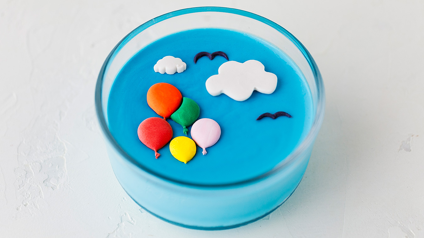 Amoretti Recipe: Coconut Blue Raspberry Panna Cotta decorated with balloons