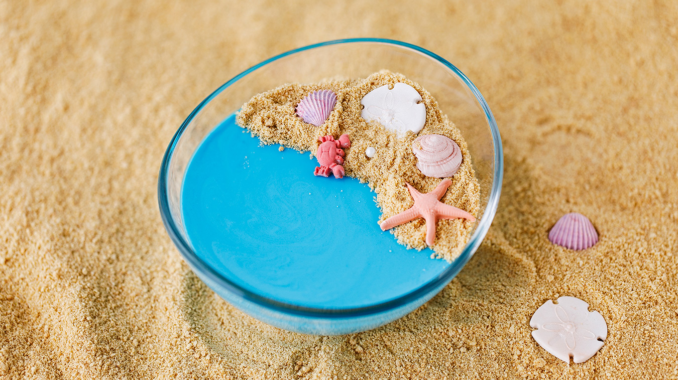 Amoretti Recipe: Coconut Blue Raspberry Panna Cotta decorated like a beach