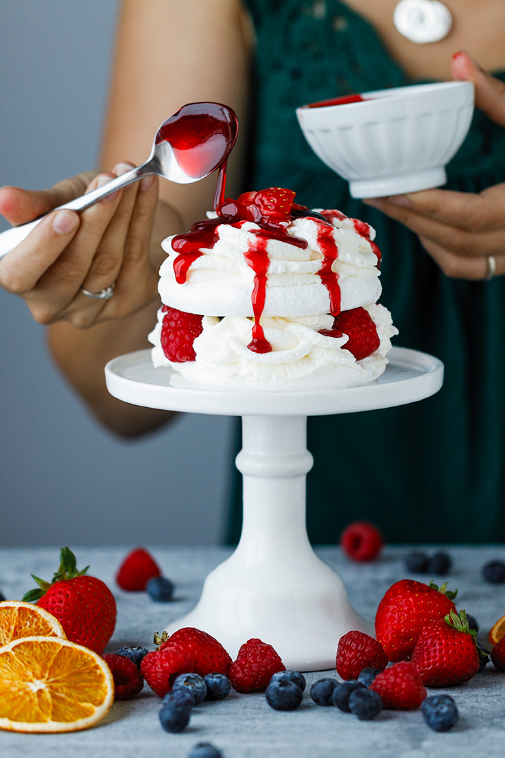 Amoretti Pavlova with Fresh Berries Recipe drizzled with Raspberry Swirl