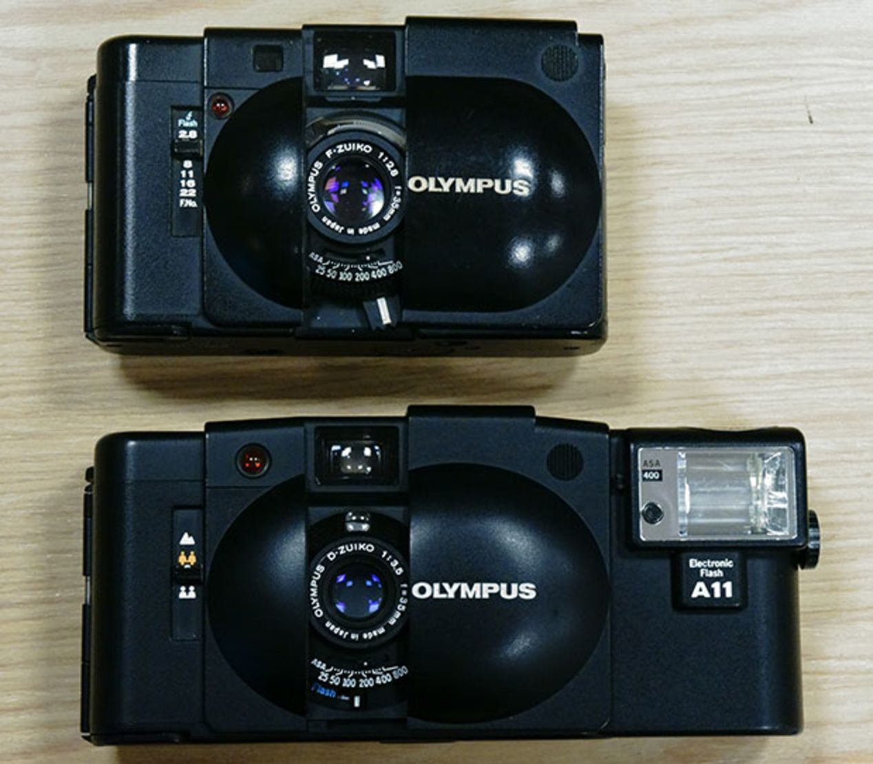 Olympus XA, typically costing $65-75 with dedicated flash.