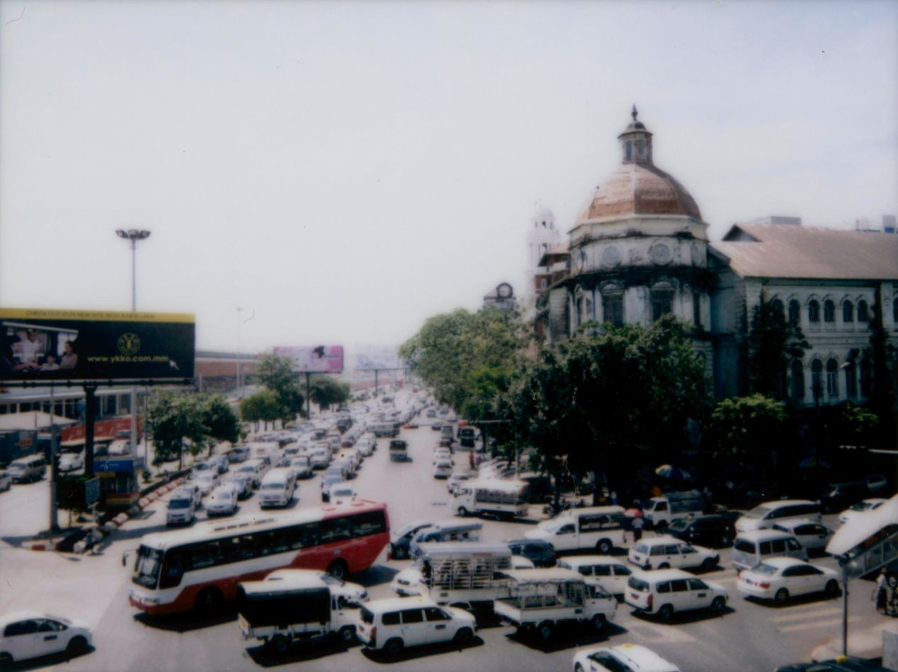 A busy intersection in downtown Yangon. Shot on Instax Mini 90.