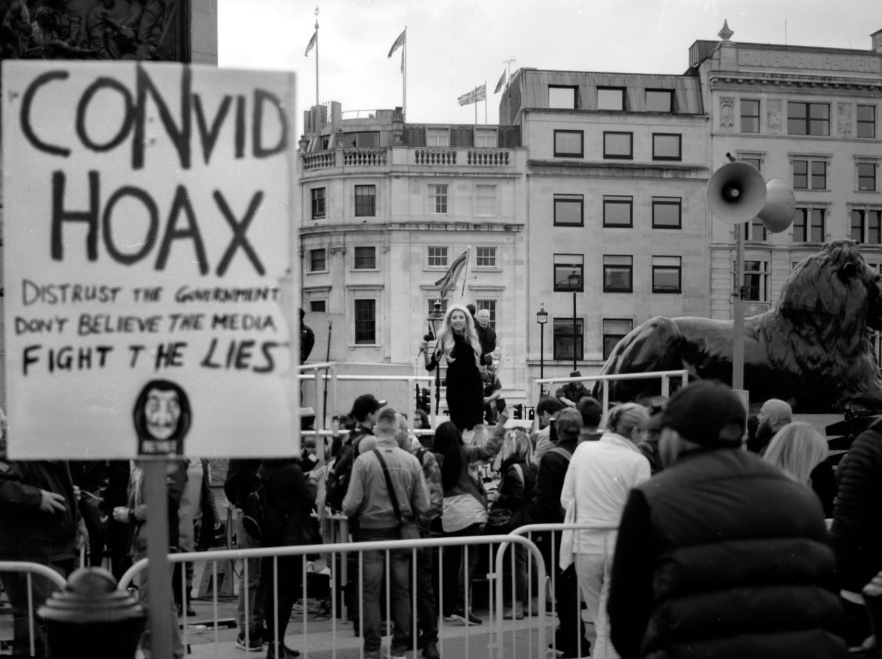 COVID skeptics protesting on 30 August 2020 in Trafalgar Sq., London. Taken with Fujifilm GA645Zi on Shanghai GP3 120 film, 100 ISO, developed for 1 hour in Rodinal 1 + 100 solution, at 20 degrees Celsius.