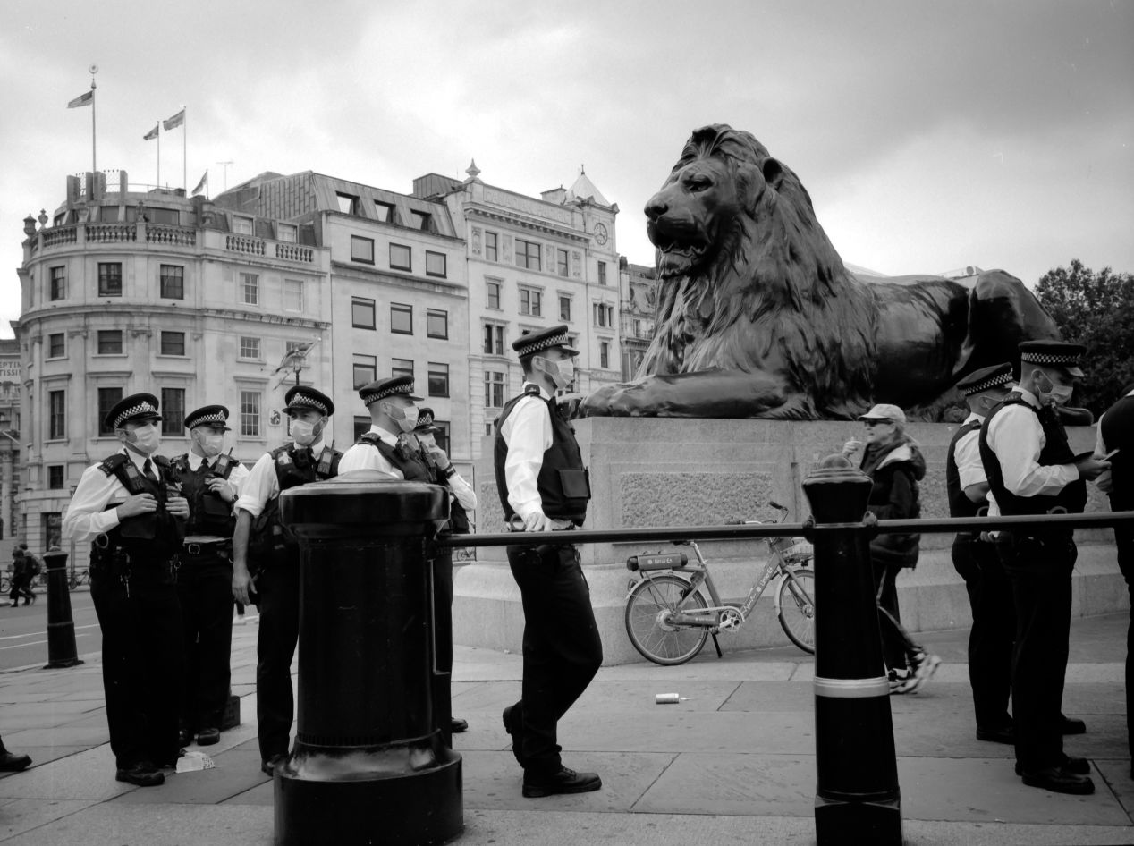 All the police wearing face masks at the COVID skeptics protest on 30 August 2020 in Trafalgar Sq., London. Taken with a Fujifilm GA645Zi on Shanghai GP3 120 film, 100 ISO. Developed for 1 hour in Rodinal 1 + 100 solution, at 20 degrees Celsius.