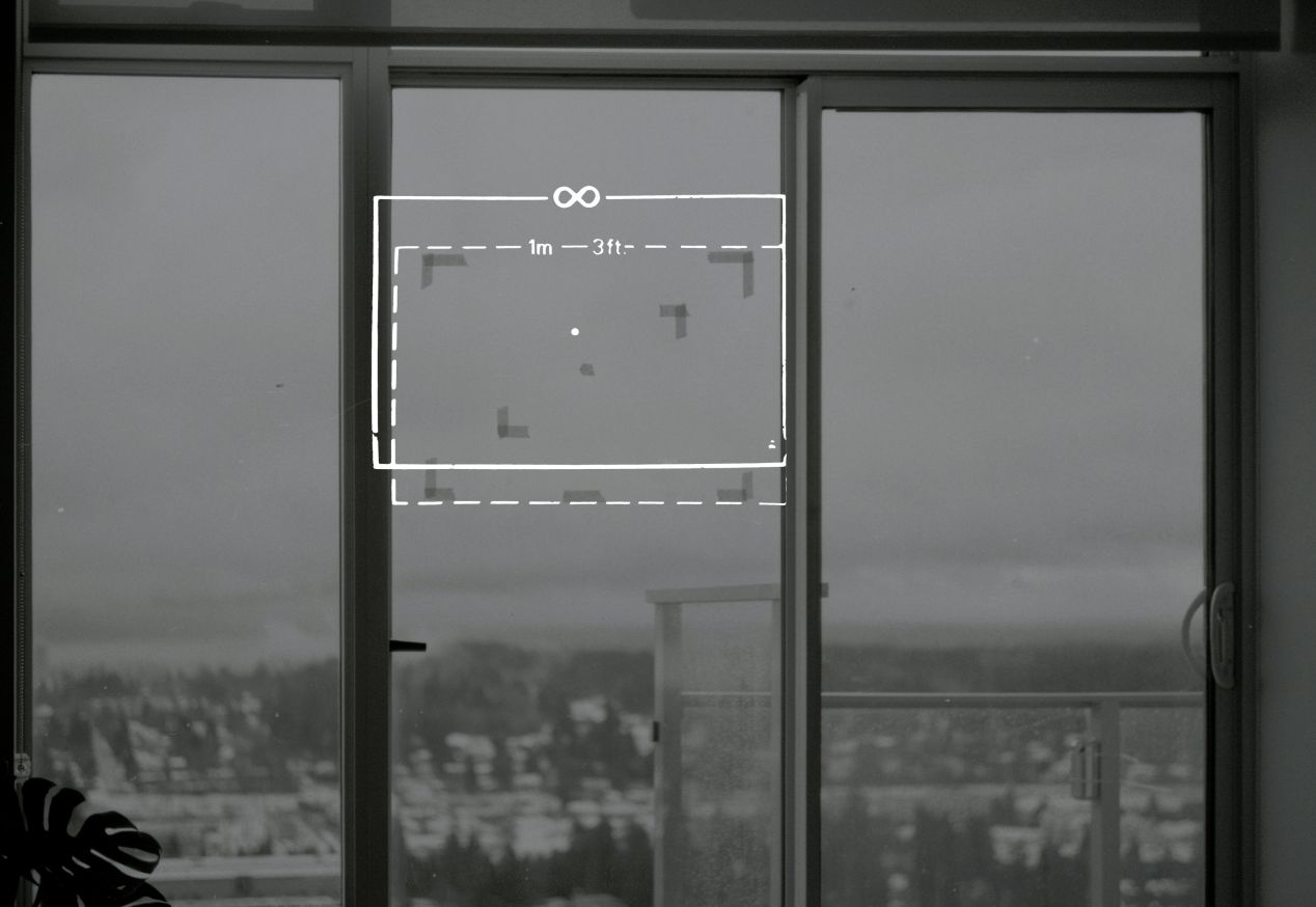 I aimed my Voigtländer Kontur's dotted outline to match the taped frame on my window, a meter away from the camera. The tape markings aren't perfect, though I think they're still helpful enough in illustrating the viewfinder's accuracy.