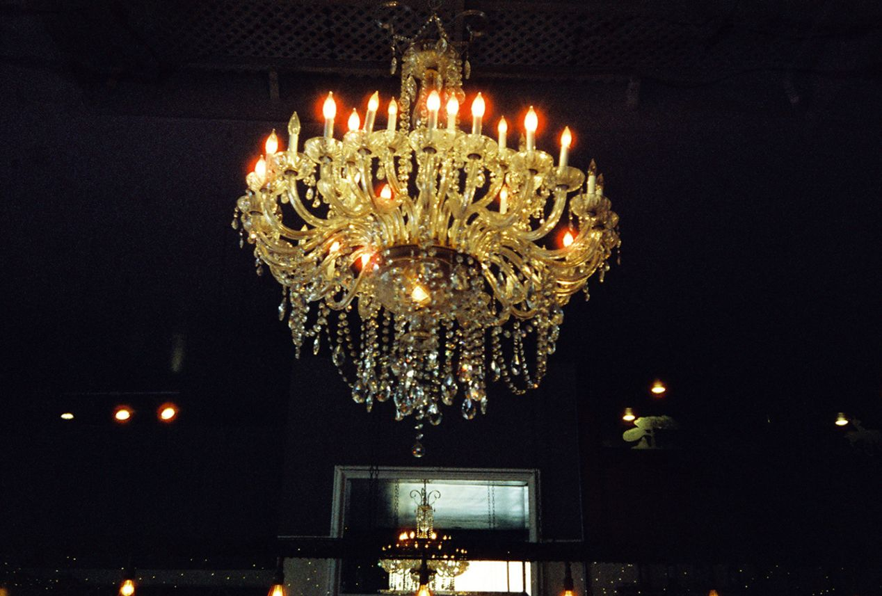 Flickering Halo Glow on Chandelier Lights in Carlsbad, California. Taken with a Yashica T5 and CineStill 800T film.