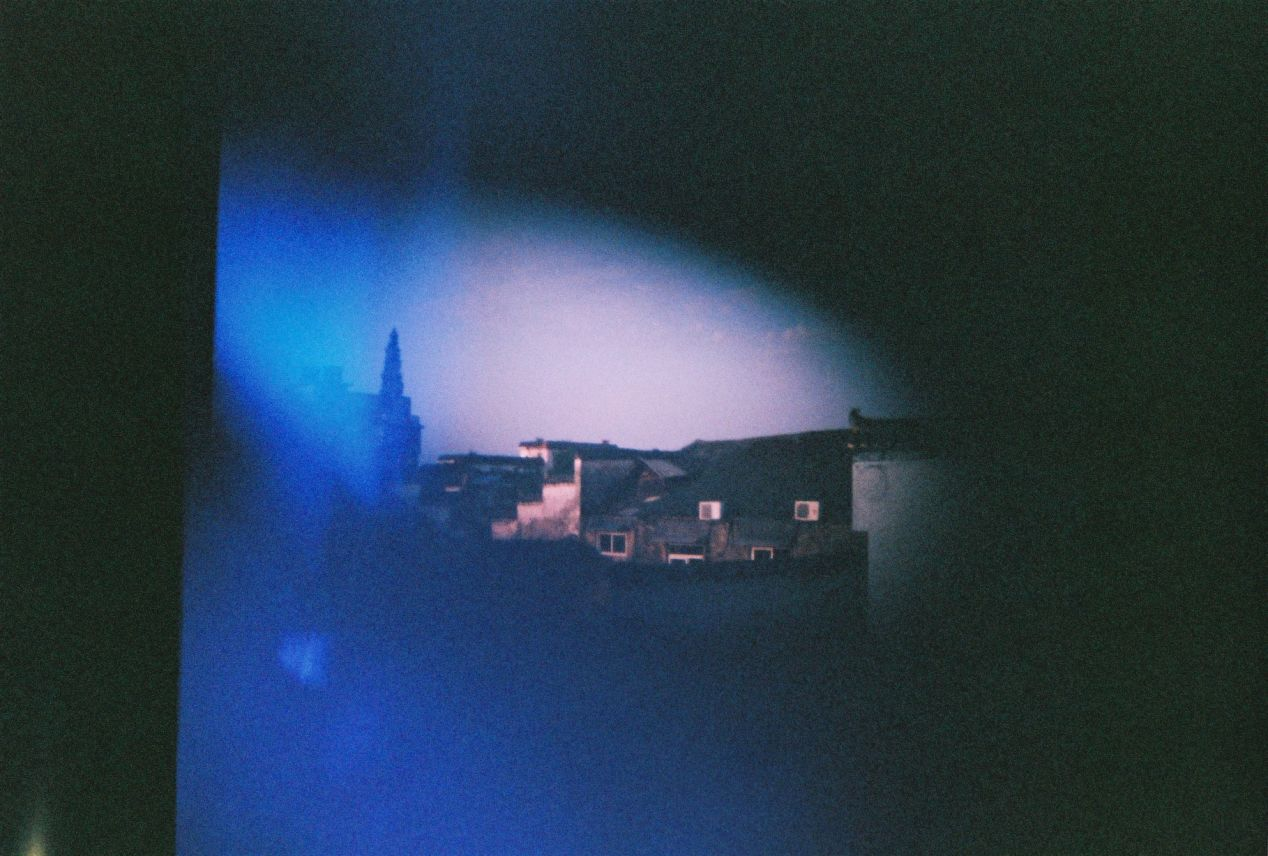 The last exposure by my Diana Mini was taken from a hostel in China overlooking the roofs of Huangshan City.