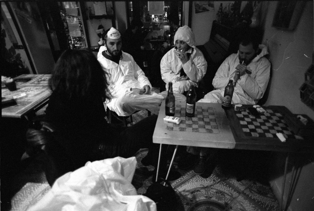 Party costumes from a past gathering. Hazmat suits, masks, and cigarettes.