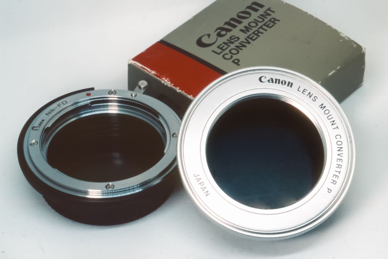 Adaptors for non-FD lenses: on the left, for F-mount lenses to an FD-mount camera (third party adaptor) and on the right, Canon-made adaptor for M42-mount lenses to FD-mount camera. This photograph is taken with a Nikon F5 and a Macro Tokina AF 100 mm f./2.8 on Fujichrome Provia 100F.