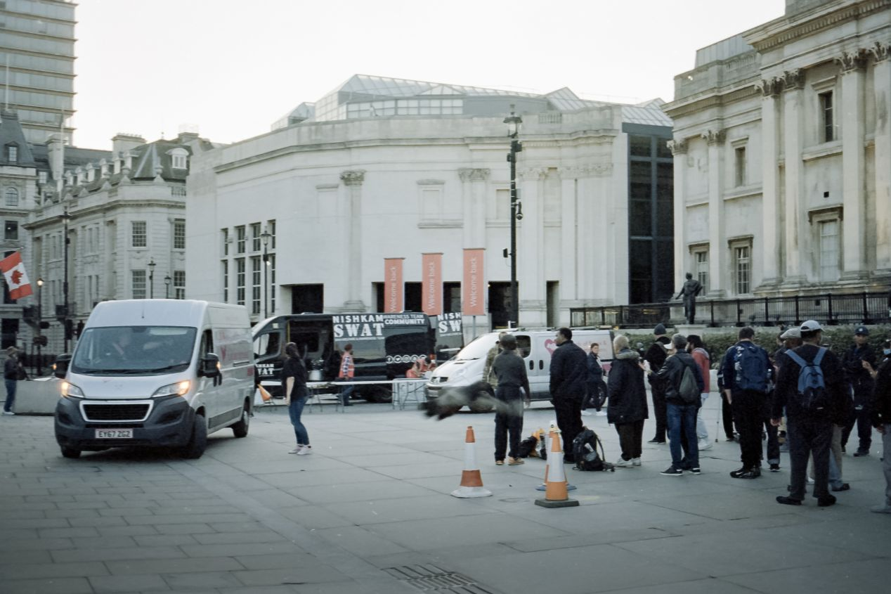 Vans from the charities setting up a food station in front of the National Gallery, Trafalgar Square, Summer 2020 (Svema Color 125).