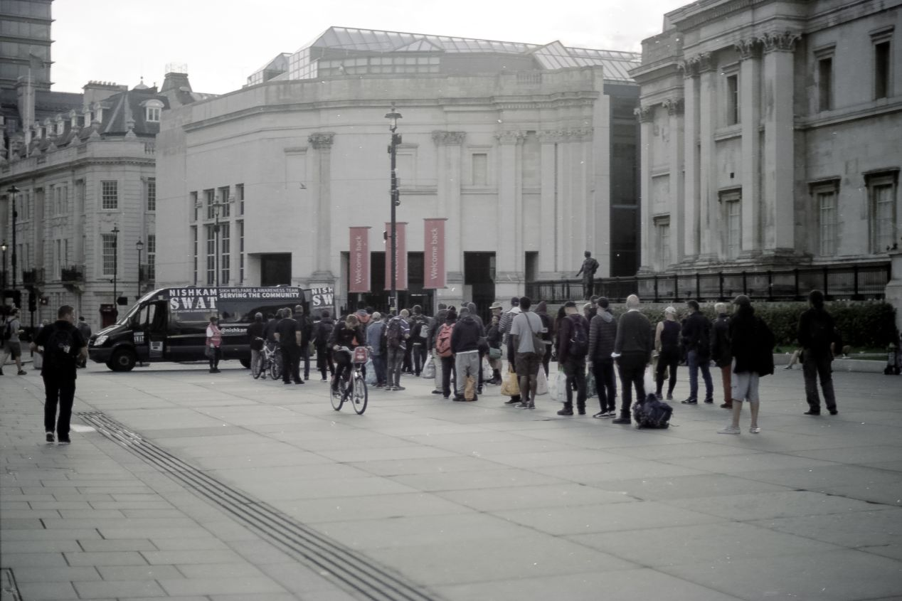 Food lines in front of the National Gallery, Trafalgar Square (Svema Color 125).