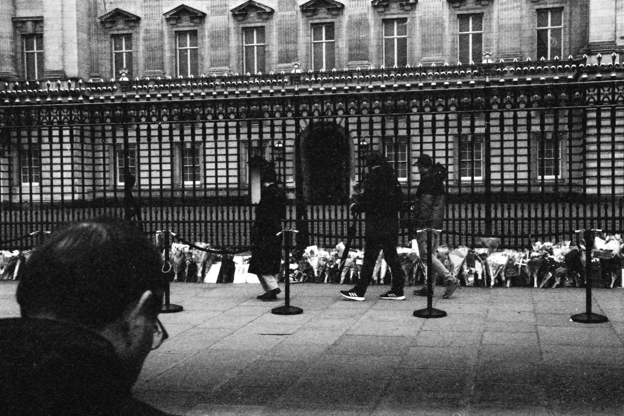 People at the gates, Buckingham Palace, London, 9-10 April 2021. Taken with the Canon EF camera and an NFD 50 mm f./1.4 lens on Eastman Double-X film.