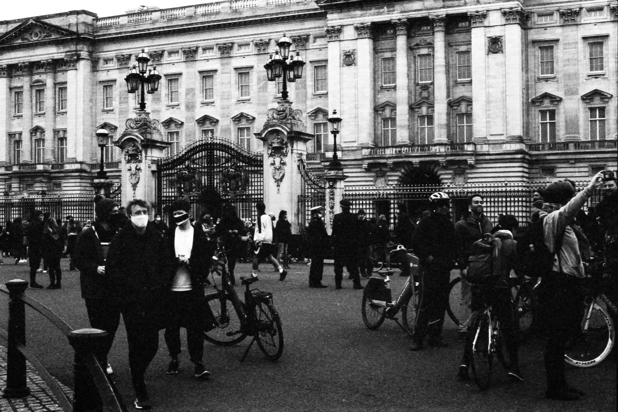 People at the gates, Buckingham Palace, 9-10 April 2021. Taken with the Canon EF camera and a Tamron 70-150 mm f./3.8 lens on Eastman Double-X film.