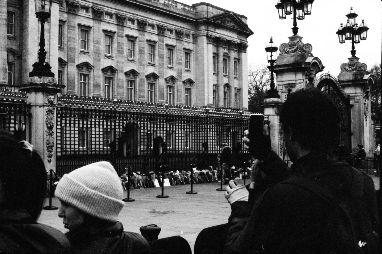 People a the gates, Buckingham Palace, London, 9-10 April 2021. Taken with the Canon EF camera with a Tamron 17 mm f./3.5 lens on Eastman Double-X film.