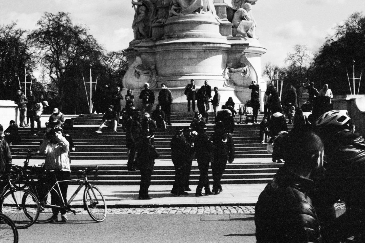 People at the gates, Buckingham Palace, London, 9-10 April 2021. Taken with the Canon EF camera and a Tamron 70-150 zoom f./3.8 on Eastman Double-X film.