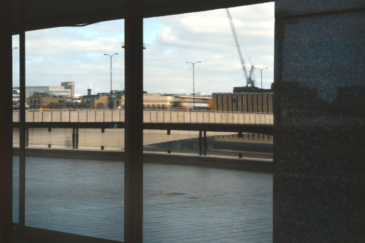 Reflection of London Bridge on the windows of St. Magnus House. 65/5.6 Fujinon.