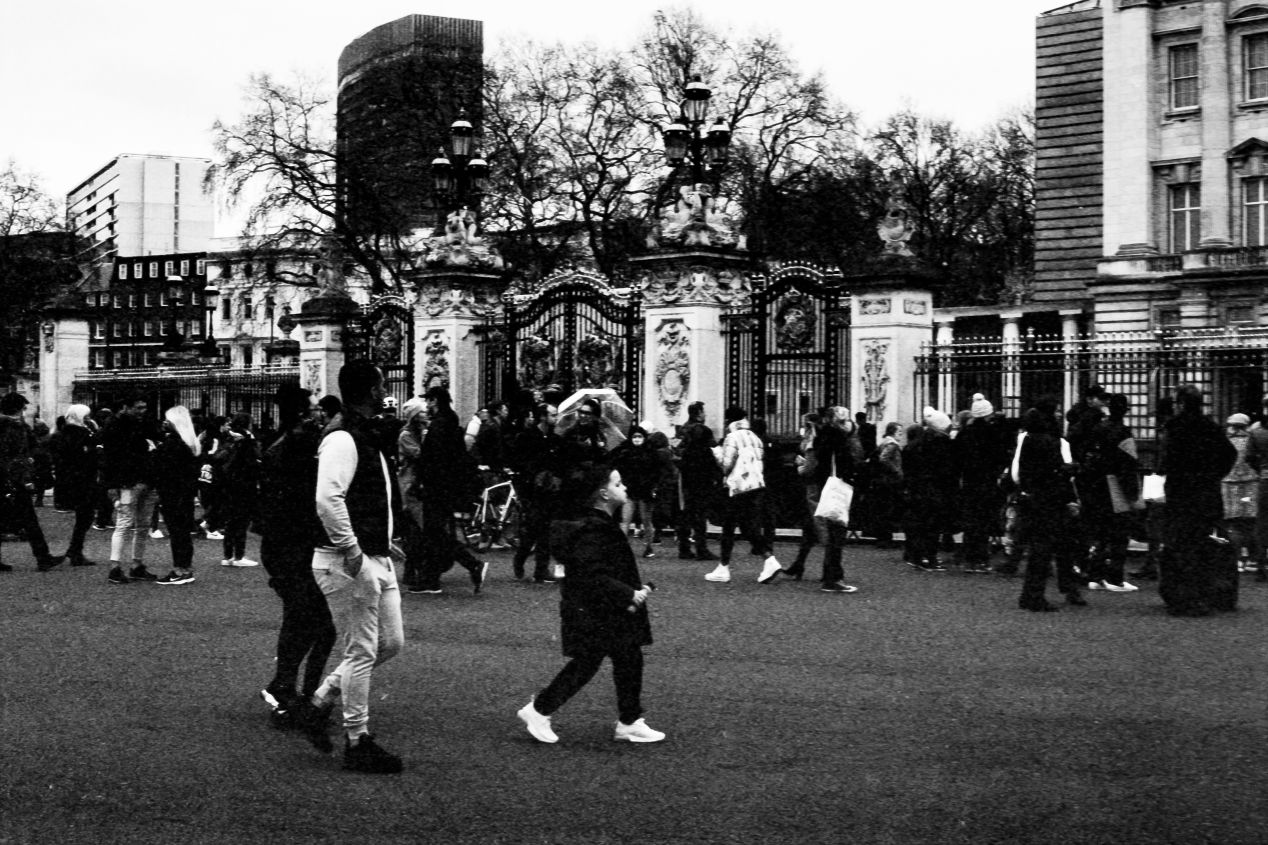 People at the gates, Buckingham Palace, London, 9-10 April 2021. Taken with the Canon EF camera and a Tamron 70-150 mm f./3.8 lens on Eastman Double-X film.